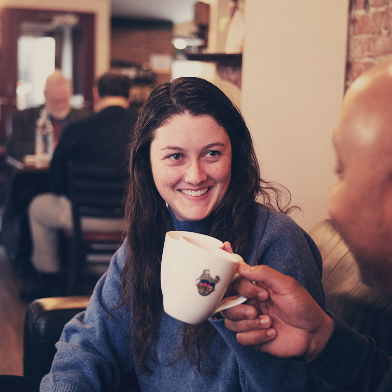 Person Smiling; coffee cup